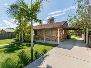 LOW MAINTENANCE HOME WITH BIG BACKYARD AND DUAL SIDE ACCESS