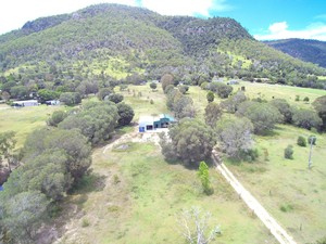 10 USEABLE ACRES, SHEDS GALORE